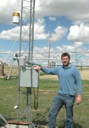 Will Corsi, AgWeatherNet technical coordinator, near a recording station.