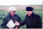 WSU researcher Robert E. Allan (left) with Nobel Peace Prize winner Dr. Norman E. Borlaug, at Spillman Farm, May 1995. Borlaug is credited with fathering the Green Revolution.