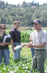 WSU Soil Scientist Craig Cogger explains growing cycles at a Puyallup Field Day.