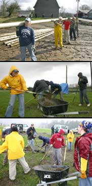 Cleared from two feet of mud, student volunteers moved irrigation pipe and cleaned flood debris out of a pasture. Photos: Denny Fleenor.Student volunteers moving irrigation pipe they had dug out of