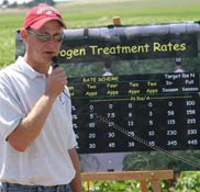 Grad student Chris Hiles explains his research at the recent WSU Potato Field Day in Othello.
