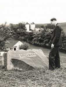 In this undated photo, Leonard Young, an administrator in the College of Agriculture from 1936 to 1968, looks at the Spillman marker at the marker's original location near Johnson Hall. The closest building in the background is the Livestock Pavilion.
