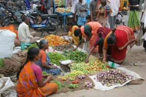 Women in India sell vegetables for a living as well as shop for vegetables for their families. Photo: Naidu Rayapati