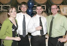 Renee Stout (left) with WSU Viticulture and Enology program students Jason Stout, Cameron Rushton, and Dane Scarimbolo at the gala.
