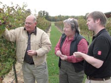 Sara Spayd, center, with North Carolina colleagues Jack Loudermilk, left, Yadkin County Extension Director (retired) and Dr. Trevor Phistor, Assistant Professor (Enology-Microbiology, Food Science, NCSU). Photo: Suzanne Stanard, News Editor, CALS Communications Services, NCSU.