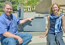 Chad Kruger and Lynne Carpenter-Boggs with prototype for a small-size anaerobic digester. (Photo by Tim Marsh, WSU Today)
