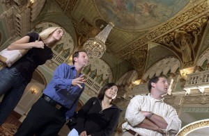 WSU associate professor of interior design John Turpin, second from left with (from left) students Nicole Kelln, Miwa Fukumoto and Sean Doherty. Turpin is on DesignIntelligence's Top 25 list of design educators. Here, he is pointing out features in the interior of Spokane's Hotel Davenport.