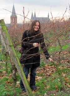 Michelle Moyer in a vineyard in Oppenheim, Germany. St. Catharine's Church is in the background. Photo by Franziska Doerflinger.