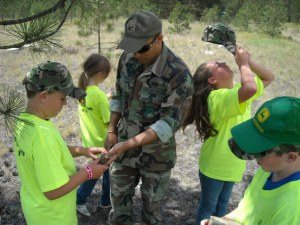National Air Guard servicemember shows military youth how to use a GPS during a survival camp at Fairchild AFB in Spokane.