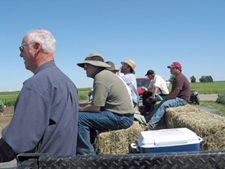Growers and researchers share information (and lunch) at field days.