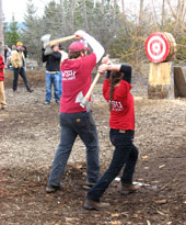 Loggersports team members throwing axes