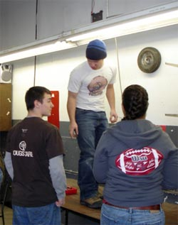 Eric, Nick, and Lauren installing shelves at Hope Center in Moscow, Idaho.