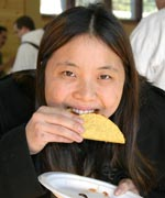 Kirsten Smith bites in to a mealy worm taco