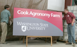 The new sign that will mark the entrance to the Cook Farm is unveiled.