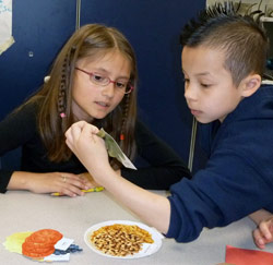 Edison students Michelle Perez-Garcia and Thomas Swiatek study fiber cards to learn about fiber content in different foods.