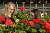 Horticulture Terresa Koenig working in the Wilson Road greenhouse with a student