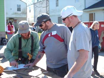 Jerry Langreder and Nick Magnuson traded golf clubs for hammers while volunteering for Habitat for Humanity