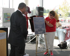 While Washington State University President Elson S. Floyd looks on, Dick Vogel, Orville A. Vogel's son, and Dick's wife Pat, unveil a replica of a plaque that will be displayed in the main entrance of the Orville