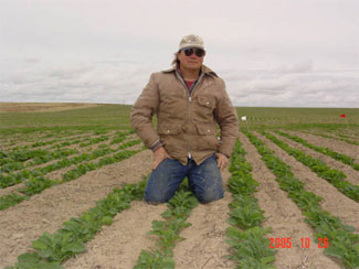 Cooperating farmer Ron Jirava near Ritzville in newly established winter canola.