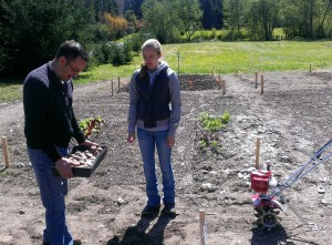 Jeff Reyes and daughter Sari getting ready to plant potatoes. Photo by Derrell Sharp.