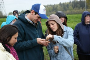 Students at the International Association for Students in Agriculture and Related Sciences summit examined different soils last week. Photo by Nik Grimm.