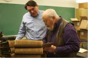 Dean Glawe and Jack Rogers glimpse into the collections from some of the earliest mycologists. Photo by Rachel Webber.