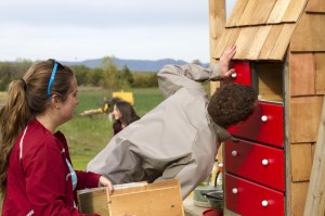 Ciara Dahm and Kyle Braun inspect the MAC's chicken roost. (Photo by Kate Wilhite, WSU)