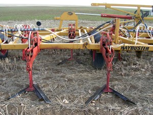 An undercutter with V-shaped blades used for primary spring tillage with fertilizer injection during the fallow year.