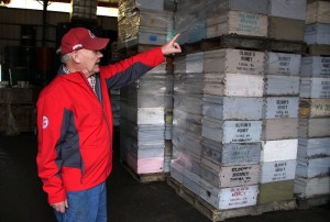 Eric Olson with pallets of empty hive boxes.  Photo by Darrell Kilgore, WSU.