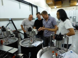 Mark Holst (far left) and Neel Karkhanis (far right), Cypress Semiconductor Corp., setting up the new wine fermentation system with Washington State University staff Richard Larsen (middle left) and Philip Teller (middle right).