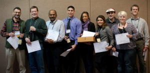 WSU viticulture and enology students and faculty with their awards at the Washington Association of Wine Grape Growers annual conference in Feb. 2015. Pictured from left to right: Markus Keller, Richard Larsen, Naidu Rayapati, Zachary Cartwright, Leslie Holland, Golnaz Badr, Joe Sperry, Brooke Kietzman, Les Walker.