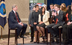 Parker Byington talks with Secretary of Agriculture Tom Vilsack  at the 2015 Agricultural Outlook Forum.