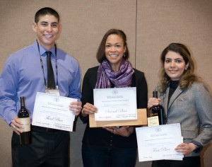 Badr (right) won first place in the graduate student poster category at the Washington Association of Grape Growers conference, for her research on land suitability for growing grapes.