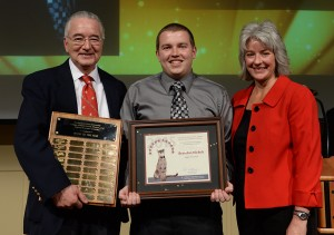 Brandon Nickels, center, is the 2015 Aggie of the Year. He accepted the award at CAHNRS Honors from Dean Ron Mittelhammer and Executive Associate Dean Kim Kidwell. Shelly Hanks/WSU Photo
