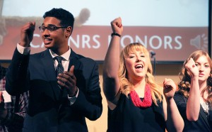 From left, Gary Barquet, Dany Cavadini and Courtney Piece sing the WSU fight song to cap the night.