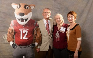 Volunteers of the Year Jim and Lee Ella Ruck, with Barb Smith, pose with Butch T. Cougar at the CAHNRS Honors event. Shelly Hanks/WSU Photo