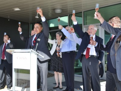 WSU Tri-Cities Chancellor Keith Moo-Young leads the Board of Regents and Washington State Wine Commission President Steve Warner in a toast to the grand opening of the Ste. Michelle Wine Estates WSU Wine Science Center.