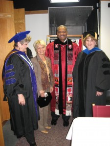 President Floyd, center, wears his new regalia in 2007, created by Linda Arthur Bradley, far left. Also pictured are Willemina Kardong, Director of Presidential Events, and Karen K. Leonas, former AMDT department chair.
