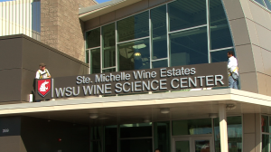 The sign atop the new Ste. Michelle Wine Estates WSU Wine Science Center is unveiled.