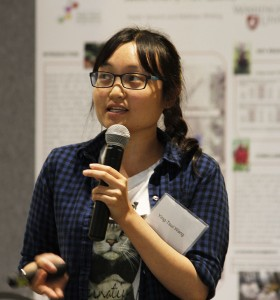 Doctoral student Ying-Tsui Wang shares her model of apple tree growth at the expo.