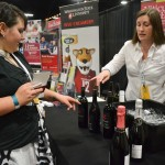 Erika Holmes, viticulture and enology communications, helps an attendee select a Blended Learning wine to taste.