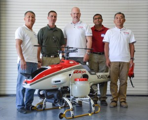 WSU's Lav Khot, second from right, and team with the UAV.