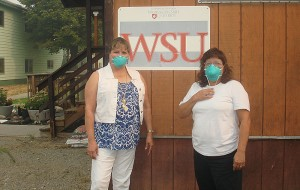 Linda McLean, director of Colville Reservation Extension 4-H programs, and Marilyn Signor, office assistant, wear masks to protect themselves from smoky air in Nespelem (Photo courtesy Colville Reservation Extension).