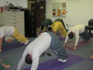 Participants in the Fit Fathers, Successful Families, Inside and Out class during a yoga session.