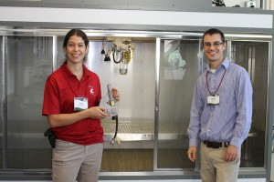 Tara Lewis and Kevin Squires, graduate students studying Crop and Soil Sciences, show off the facility's new high-tech spray chamber, which will enhance herbicide studies.