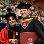 Michelle Moyer, Left, congratulates graduate student, Eric Gale during the WSU Tri-Cities Commencement Ceremony