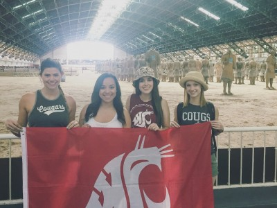 Alison DePhillips, Graciela Vela, Yeseily Pruneda, and Kaitlyn Jo Engle hold the WSu banner at the ancient Terracotta Warriors site in Xi'an.