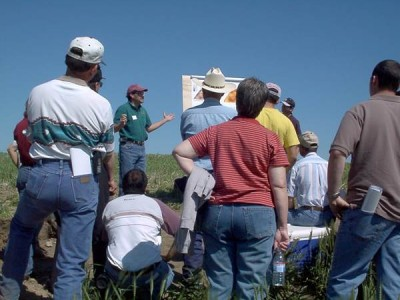 WSU-based USDA-ARS soil scientist David Huggins speaks with farmers at a past Cook Agronomy Farm Field Tour. The event returns June 22, 2016.