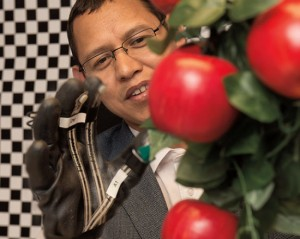 WSU Assistant Professor Manoj Karkee, above working with an apple-picking robot, is organizing the 2016 Agricontrol conference.