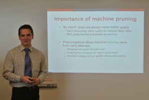 Chris Jenkins gives his thesis defense to earn his masters degree in food science.